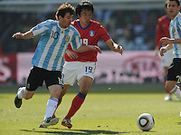 Lionel Messi keeps possession though closely guarded by his South Korean marker. Argentina defeated South Korea, 4-1, in both teams' second match of play in Group B of the 2010 FIFA World Cup. The match was played at Soccer City in Johannesburg, South Africa June 17th.