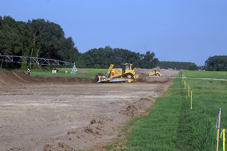 The right of way has to be leveled and cleared prior to the pipeline being installed.  The top soil is graded to one side so it can be spread back over the ROW after the pipe has been covered.
