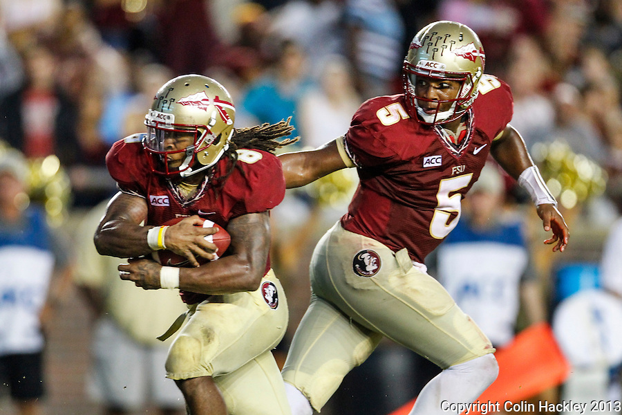 TALLAHASSEE, FLA 9/21/13-FSU-BCC092113CH-Florida State quarterback Jameis Winston, right, hands off to Devonta Freeman for a touchdown against Bethune-Cookman during first half action Saturday at Doak Campbell Stadium in Tallahassee. <br /> COLIN HACKLEY PHOTO