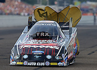 Aug 16, 2014; Brainerd, MN, USA; NHRA funny car driver Courtney Force during qualifying for the Lucas Oil Nationals at Brainerd International Raceway. Mandatory Credit: Mark J. Rebilas-
