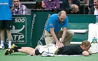 11-02-14, Netherlands,Rotterdam,Ahoy, ABNAMROWTT,Dmitry Tursunov(RUS) Medical treatment<br /> Photo:Tennisimages/Henk Koster