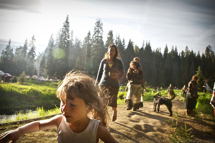 """The yearly gathering of the Rainbow Family of Living Light took place in the  Gifford Pinchot National Forest, in the Washington State, near Portland...Rainbow Gatherings are temporary intentional communities, typically held in outdoor settings, and espousing and practicing ideals of peace, love, harmony, freedom and community, as a consciously expressed alternative to mainstream popular culture, consumerism, capitalism and mass media. These gatherings are an expression of a Utopian impulse, combined with bohemianism, hipster and hippie culture, with roots clearly traceable to the 1960s' counterculture. ..A 4-weeks road trip across the USA, from New York to San Francisco, on the steps of Jack Kerouac's famous book """"On the Road"""".  Focusing on nomadic America: people that live on the move across the US, out of ideology or for work reasons."""