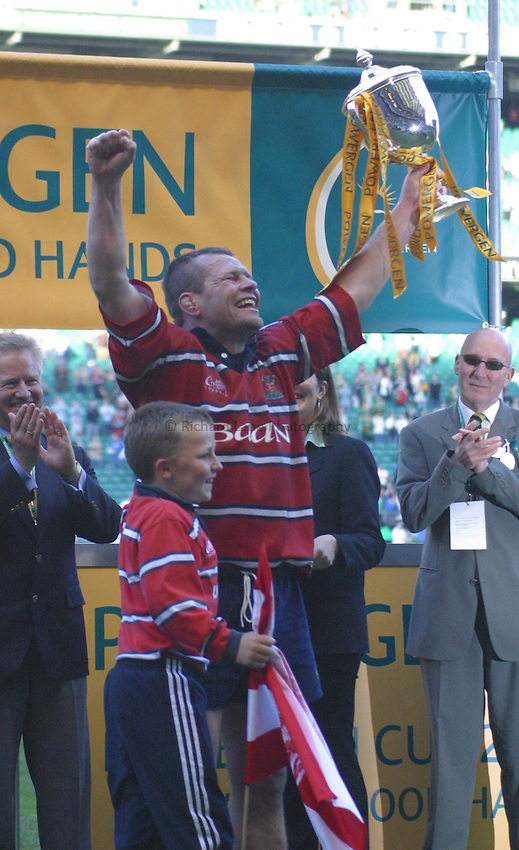 Photo. Jo Caird.Gloucester v Northampton Saints. Powergen Cup Final. 05/04/2003.Andy Deacon holds up the trophy.