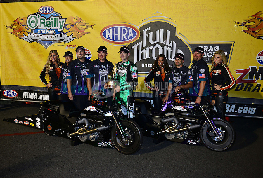 Sept. 16, 2012; Concord, NC, USA: NHRA pro stock motorcycle rider Andrew Hines celebrates with his crew after defeating teammate Eddie Krawiec to win the O'Reilly Auto Parts Nationals at zMax Dragway. Mandatory Credit: Mark J. Rebilas-