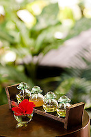 Glass jars containing oil for massage therapies on a special tray