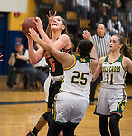 WATERBURY,  CT-021819JS26-  Watertown's Jordyn Forte (5) gets off a shot in front of Holy Cross' Ja'Lin Waters (25) and Hannah Brown (11) during their NVL semi-final game Monday at Kennedy High School in Waterbury. <br /> Jim Shannon Republican American