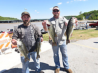 NWA Democrat-Gazette/FLIP PUTTHOFF <br /> Dustin Simon (left) and Rance Carter show largemouth bass from their winning catch Saturday May 7 2017 at Beaver Lake. They had five bass at 17.03 pounds and won a bass boat, motor and trailer.