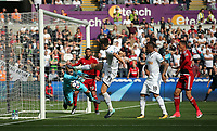 Heurelho Gomes of Watford (L) stops the ball from a near tap in by Federico Fernandez of Swansea City (33) during the Premier League match between Swansea City and Watford at The Liberty Stadium, Swansea, Wales, UK. Saturday 23 September 2017