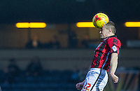 Andy Parrish of Morecambe heads the ball during the Sky Bet League 2 match between Wycombe Wanderers and Morecambe at Adams Park, High Wycombe, England on 2 January 2016. Photo by Andy Rowland / PRiME Media Images