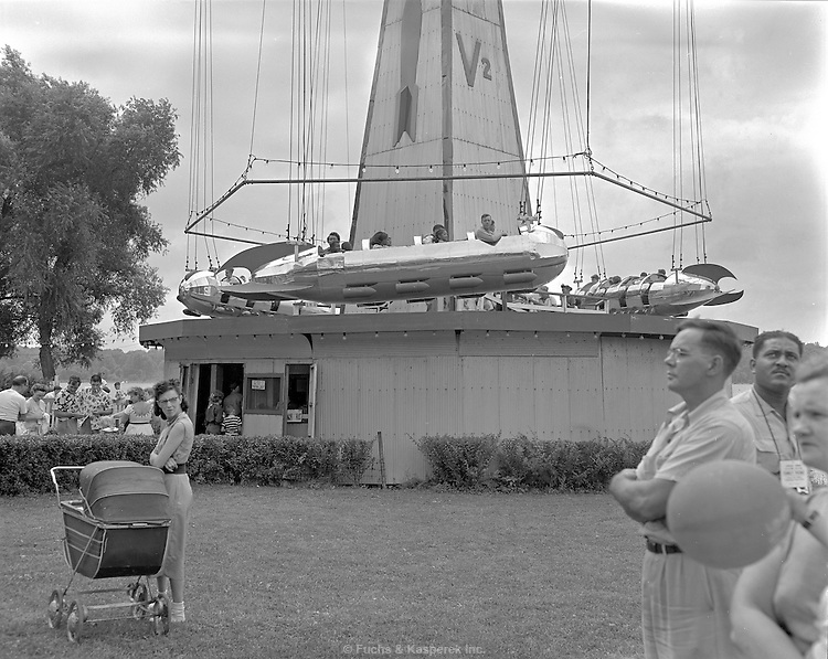 AFL-CIO Union outing at Chippewa Lake amusement park. 1953. The V2 ride, several of the cars were converted to auto chasis when the park closed.