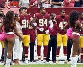 Washington Redskins players lock arms as the National Anthem is played prior to the game against the San Francisco 49ers at FedEx Field in Landover, Maryland on Sunday, October 15, 2017.  From left to right: outside linebacker Ryan Kerrigan (91); outside linebacker Preston Smith (94) and cornerback Quinton Dunbar (47).<br /> Credit: Ron Sachs / CNP