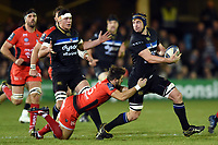 Paul Grant of Bath Rugby looks to offload the ball after being tackled. European Rugby Champions Cup match, between Bath Rugby and RC Toulon on December 16, 2017 at the Recreation Ground in Bath, England. Photo by: Patrick Khachfe / Onside Images