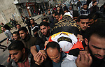 Mourners carry the body of Palestinian Jihad Harara, 23, who was shot dead by Israeli forces during clashes with Israeli troops in tents protest where Palestinians demand the right to return to their homeland at the Israel-Gaza border, during his funeral in Gaza City, on March 23, 2019. Photo by Mahmoud Ajjour