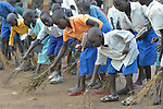 Students sweep the school grounds at a primary school at Odoubu in the Rhino Refugee Camp in northern Uganda. As of April 2017, the camp held almost 87,000 refugees from South Sudan, and more people were arriving daily. About 1.8 million people have fled South Sudan since civil war broke out there at the end of 2013. About 900,000 have sought refuge in Uganda.
