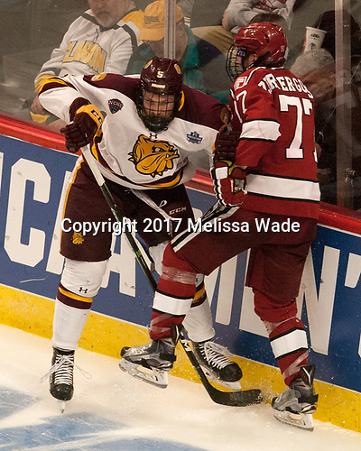 Nick Wolff (UMD - 5), Lewis Zerter-Gossage (Harvard - 77) - The University of Minnesota Duluth Bulldogs defeated the Harvard University Crimson 2-1 in their Frozen Four semi-final on April 6, 2017, at the United Center in Chicago, Illinois.