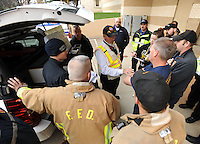 NWA Democrat-Gazette/ANDY SHUPE<br /> Battalion Chief Travis Boudrey (center) speaks Wednesday, Nov. 25, 2015, to firefighters during a hazardous-materials and confined-space extrication drill in Kimpel Hall on the University of Arkansas campus in Fayetteville. The quarterly training exercise involved Fayetteville, Springdale and Rogers fire departments as well as Central EMS and the University of Arkansas Police Department. Personnel removed an injured patient through a tunnel system during a mock campus shooting event.