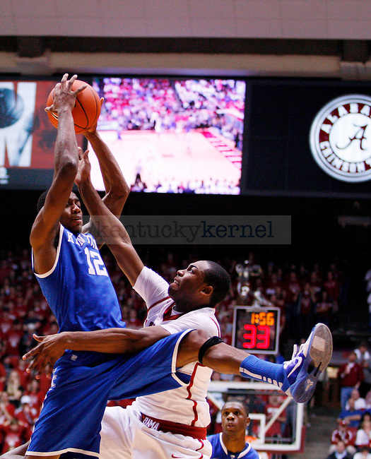 Brandon Knight snags a reboudn in the first half of the UK men's basketball game against the Alabama Roll Tide at Coleman Arena  on Jan. 18, 2011. Photo by Britney McIntosh | Staff