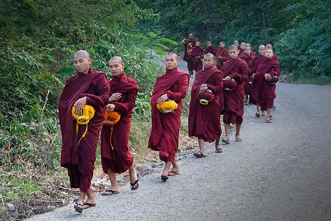 Monks near Mt. Popa, Burma seeking their daily alms