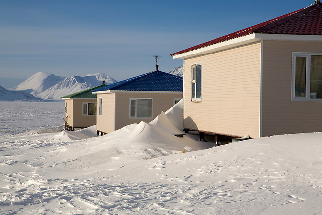 Modern houses in the Yupik Eskimo village of New Chaplino. Chukotskiy Peninsula, Siberia, Russia