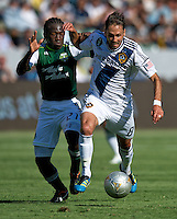 CARSON, CA - June 17, 2012: Portland Timbers midfielder Diego Chara (21) and LA Galaxy midfielder Marcelo Sarvas (8) during the LA Galaxy vs Portland Timbers match at the Home Depot Center in Carson, California. Final score LA Galaxy 1, Portland Timbers 0.