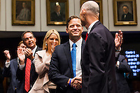 TALLAHASSEE, FLA. 11/18/14-ORGSESS111814CH-Lt. Gov. Carlos Lopez-Cantera, center, shakes hands with Gov. Rick Scott, right as he is recognized during Organizational Session of the Legislature, Nov. 18, 2014 at the Capitol in Tallahassee.<br /> <br /> COLIN HACKLEY PHOTO