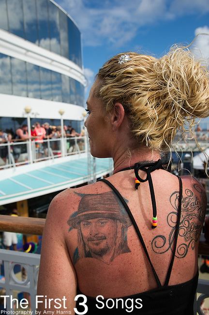 An unidentified woman with a Kid Rock tattoo on Kid Rock's 5th Annual Chillin' the Most Cruise. The cruise left Miami, Florida on March 3, 2014 sailing to Key West, Florida and Grand Stirrup Cay (Bahamas), returning on March 7, 2014. The event, produced by Sixthman, featured performances by Kid Rock and other musical artists.