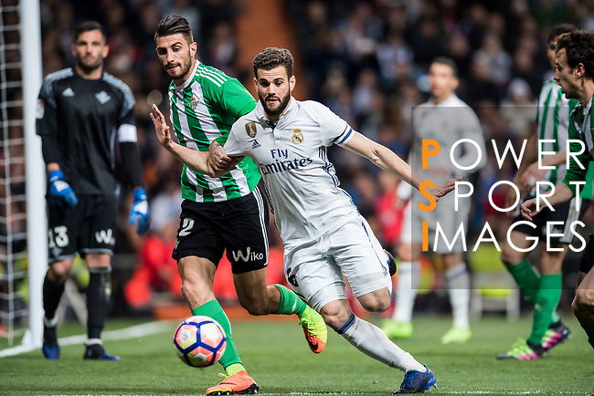 Nacho Fernandez (r) of Real Madrid fights for the ball with Cristiano Piccini of Real Betis during their La Liga match between Real Madrid and Real Betis at the Santiago Bernabeu Stadium on 12 March 2017 in Madrid, Spain. Photo by Diego Gonzalez Souto / Power Sport Images