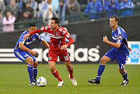 Marco Pappa , Roger Espinoza (blue)...Kansas City Wizards played to a 2-2 tie with Chicago Fire at Community America Ballpark, Kansas City, Kansas.