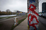 A double section of the former Berlin Wall which now doubles as an outdoor gallery for graffiti artists. The route of the Wall, which stood from 1961-1989, has been developed into the 'Mauerweg,' a thoroughfare which traces most of the route of the Wall which encircled the city and divided it into East and West Berlin during the Cold War. In the years following the 1989 civil uprising in the German Democratic.Republic, most of the Wall was removed as part of the reunification strategy which united the pro-Soviet DDR and the Federal Republic of (West) Germany.