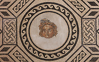 Mosaic of the head of Medusa, a gorgon, surrounded by knotted and geometric patterns, Roman, 2nd century AD, discovered in 1959 in the Salon de los Mosaicos in a wealthy Roman house in the Plaza de la Corredera, in the Alcazar de los Reyes Cristianos or Palace of the Catholic Kings, in Cordoba, Andalusia, Southern Spain. The alcazar was rebuilt during the Umayyad Caliphate in the 10th century and used as a royal fortress by the Moors and the Christians, as a base for the Spanish Inquisition, and as a prison. The alcazar is a national monument of Spain, and the historic centre of Cordoba is listed as a UNESCO World Heritage Site. Picture by Manuel Cohen