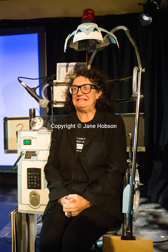 Edinburgh, UK. 12.08.13.  Scotsman Comedy Critic, Kate Copstick, in the Brainmatiser 3000 ™, on Doug Segal's show I CAN MAKE YOU A MENTALIST, at the Gilded Balloon. Photograph © Jane Hobson.
