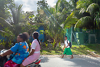 A young boy walks home from school in the Tuvaluan capital of Funafuti. Located in the South West Pacific Ocean, Tuvalu is the world's 4th smallest country and is one of the most vulnerable to climate change impacts including sea level rise, drought and extreme weather events. Tuvalu - March, 2019.