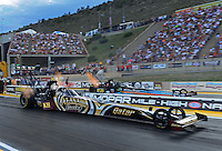 Jul, 20, 2012; Morrison, CO, USA: NHRA top fuel dragster driver Khalid Albalooshi (near lane) races alongside Steve Chrisman during qualifying for the Mile High Nationals at Bandimere Speedway. Mandatory Credit: Mark J. Rebilas-