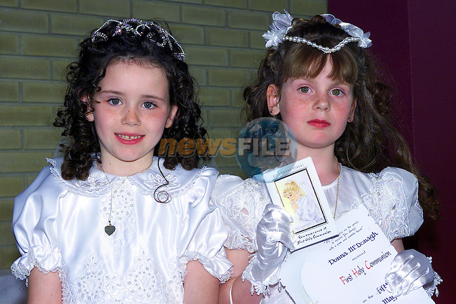 Marsella Wright and Donna McDonagh after making there first Communion in the Holy Family Church.Pic Fran Caffrey Newsfile