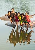 Aldeia Baú, Para State, Brazil. Keitu, Kokokinti, Irekabiri, Kokodju, Bekoikuti, Nreki jumping into the river.