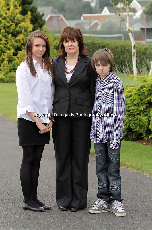 Pictured: Sonia Oatley (C) mother of tragic teen Rebecca Aylward with her young son Jack (R) and daughter Jessica (L) outside Swansea Crown Court. Friday 02 September 2011<br /> Re: A 16-year-old boy who battered his former girlfriend to death has been sentenced to a minimum of fourteen years in prison by a judge at Swansea Crown court today (Fri 02 September 2011) for her murder.<br /> Rebecca Aylward, 15, from Maesteg, was lured into a wood in Aberkenfig, near Bridgend, in October 2010. <br /> Joshua Davies denied murder, blaming his friend, but was convicted by a 10-2 majority verdict in July.