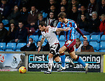 Billy Sharp of Sheffield Utd tussles with Charlie Goode of Scunthorpe Utd - English League One - Scunthorpe Utd vs Sheffield Utd - Glandford Park Stadium - Scunthorpe - England - 19th December 2015 - Pic Simon Bellis/Sportimage