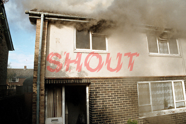 Smoke issuing from the first floor windows of a severe house fire. The.fire has already got a hold and smoke can also be seen issuing through the roof. This image may only be used to portray the subject in a positive manner..©shoutpictures.com..john@shoutpictures.com