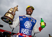 Apr 27, 2014; Baytown, TX, USA; NHRA top fuel driver Antron Brown celebrates after winning the Spring Nationals at Royal Purple Raceway. Mandatory Credit: Mark J. Rebilas-USA TODAY Sports