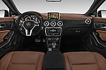 Stock photo of straight dashboard view of a 2014 Mercedes Benz CLA Class 45 AMG 4 Door Sedan