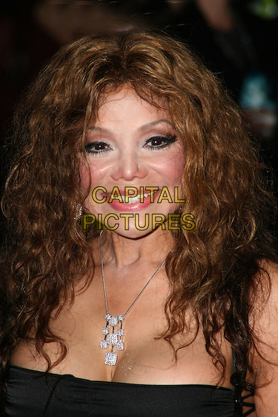 "LA TOYA JACKSON.Attending the UK film premiere of ""The Imaginarium Of Doctor Parnassus"" at the Empire Leicester Square cinema, London, England, UK, October 6th 2009..portrait headshot black Latoya necklace silver cleavage .CAP/JIL.©Jill Mayhew/Capital Pictures"