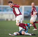 Stranraer's David MacGregor gets booked for this late challenge on Stenny's Sean Dickson.