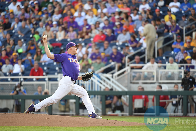OMAHA, NE - JUNE 26: Russell Reynolds (45) of Louisiana State University pitches against the University of Florida during the Division I Men's Baseball Championship held at TD Ameritrade Park on June 26, 2017 in Omaha, Nebraska. The University of Florida defeated Louisiana State University 4-3 in game one of the best of three series. (Photo by Justin Tafoya/NCAA Photos via Getty Images)