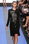 Kate walks runway in a carbon black leather wool paneled coat, by Monique Lhuillier, from the Monique Lhuillier Spring 2012 collection fashion show, during Mercedes-Benz Fashion Week Spring 2012.