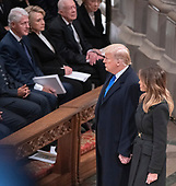 United States President Donald J. Trump and first lady Melania Trump walk past former US President Bill Clinton, former US Secretary of State Hillary Rodham Clinton, and former US President Jimmy Carter, as they arrive for the National funeral service in honor of the late former United States President George H.W. Bush at the Washington National Cathedral in Washington, DC on Wednesday, December 5, 2018.<br /> Credit: Ron Sachs / CNP<br /> (RESTRICTION: NO New York or New Jersey Newspapers or newspapers within a 75 mile radius of New York City)