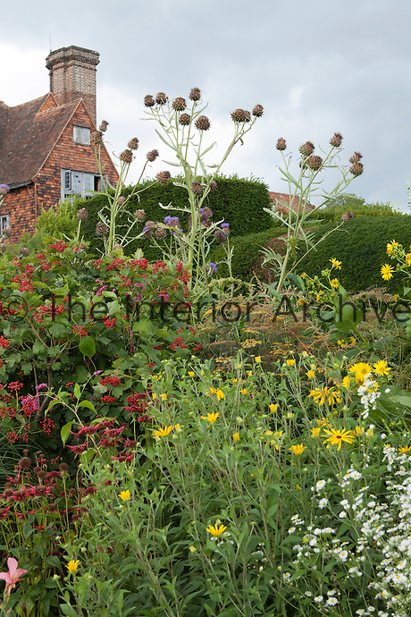 A mature summer border grows in front of the house at Great Dixter