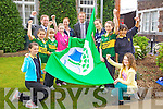 GREEN FLAG: Presentation Primary School Tralee got their fourth Green Flag which was raised by Kerry footballer Colm Cooper on Thursday last, pictured are l-r: Tammy O'Shea, Charlotte O'Halloran, Pat Sayers, Principal, Sarah Cleary, Jessica Stephenson, Angela Wall, Colm Cooper , Lauren Foley, Maya Fitzpatrick, Andrea Gergely and Megan Arnopp.
