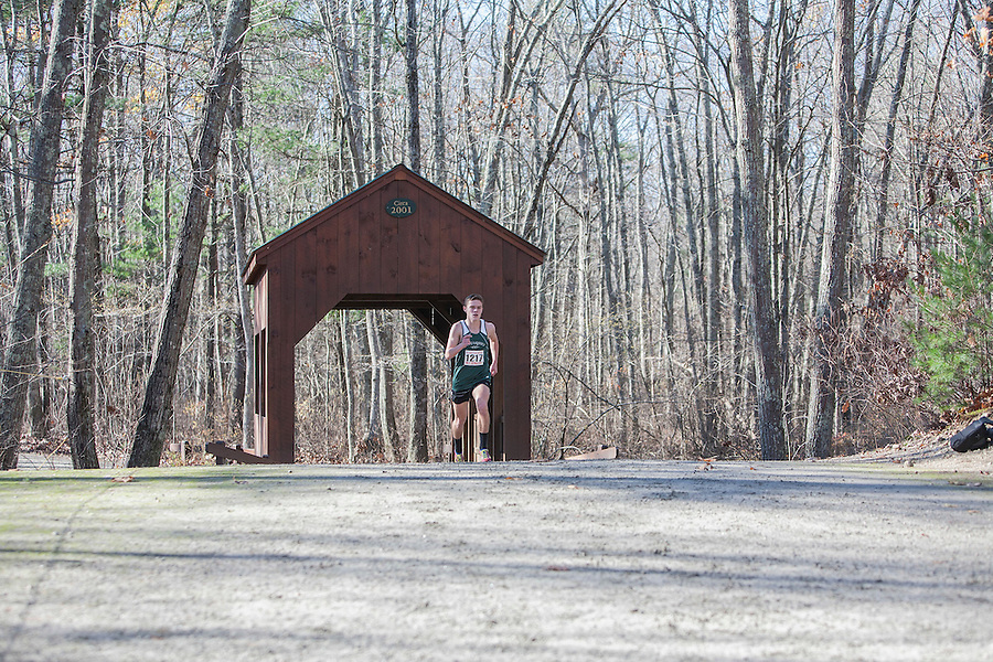 The 2012 High School Cross-Country Championships were held on Sunday afternoon at Ponaganset High School in Glocester. Chariho Senior, Bryce Kelly, comes through the covered bridge during the last 1/2 mile of the three mile course holding second place..Sun Photo by Mae gammino