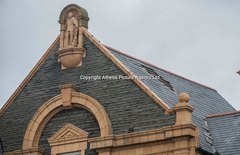 """WEATHER PICTURE WALES<br />Pictured: Tiles have come off from a building's roof in Aberystwyth, Ceredigion, Wales. Wednesday 02 March 2016<br />Re: Roads have been closed, homes left without power and tiles blown from roofs after Storm Jake brought wintry showers and high winds to Wales.<br />Yellow Met Office """"be aware"""" warnings of snow, ice and wind were issued for most of Wales for Wednesday morning.<br />Gusts - forecast to reach up to 70mph - caused roof tiles to fall and trees to be blown over in Aberystwyth, with roads closed as a precaution."""