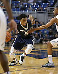 Utah State's Julion Pearre (5) drives past Nevada defender Eric Cooper (21) during an NCAA college basketball game in Reno, Nev., on Tuesday, Jan. 20, 2015. (AP Photo/Cathleen Allison)